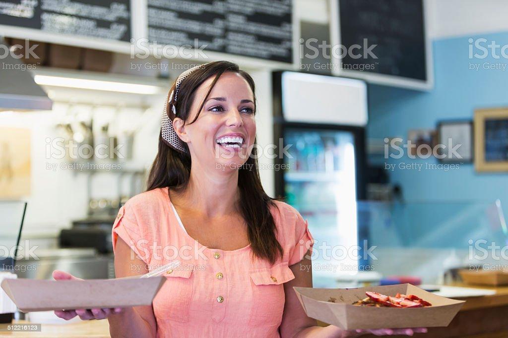 Waitress in waffle shop stock photo