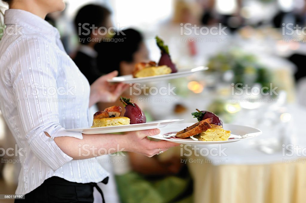 Waitress is carrying three plates stock photo