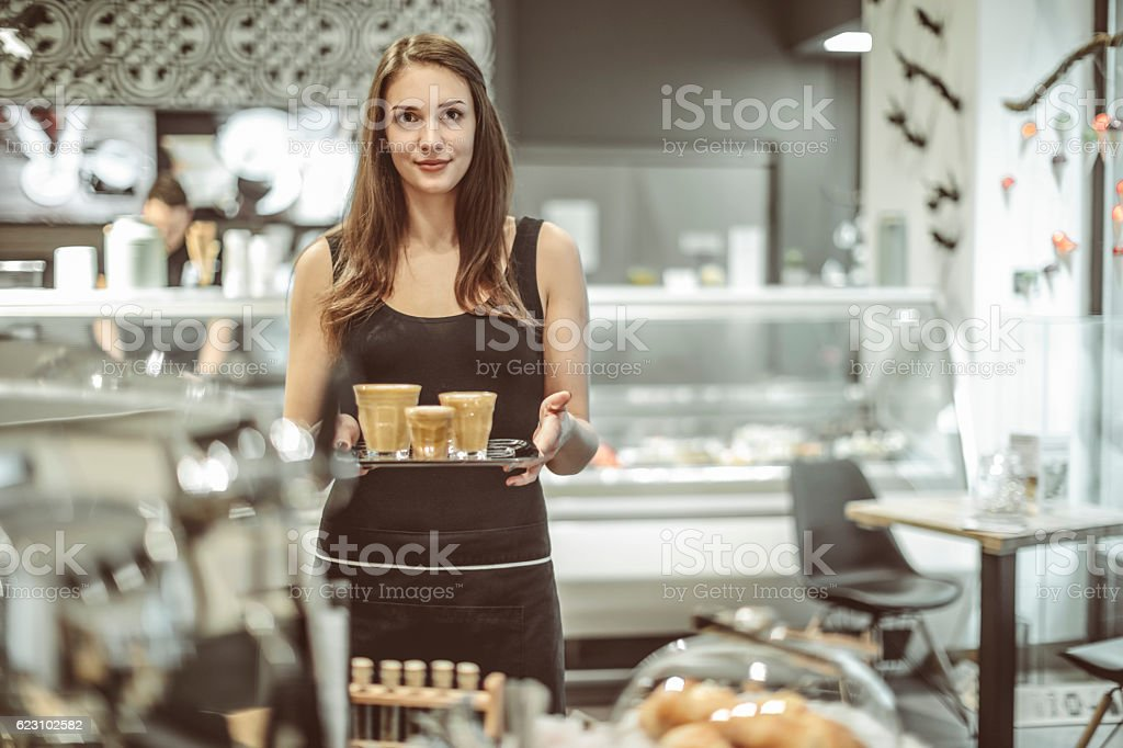 Waitress is serving a coffee stock photo