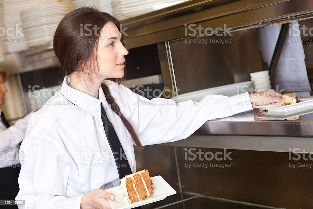 waitress picking up food to deliver royalty-free stock photo