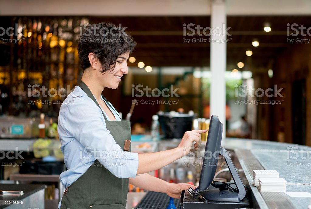 Waitress placing an order on the computer stock photo