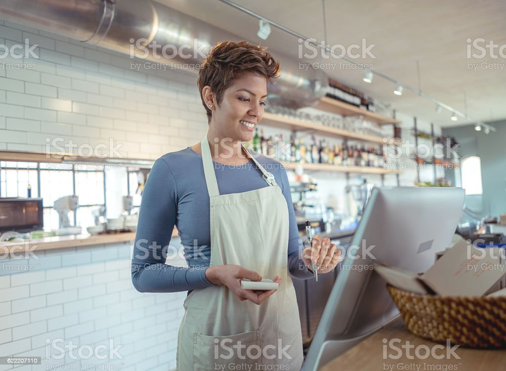 Waitress placing order in the computer stock photo