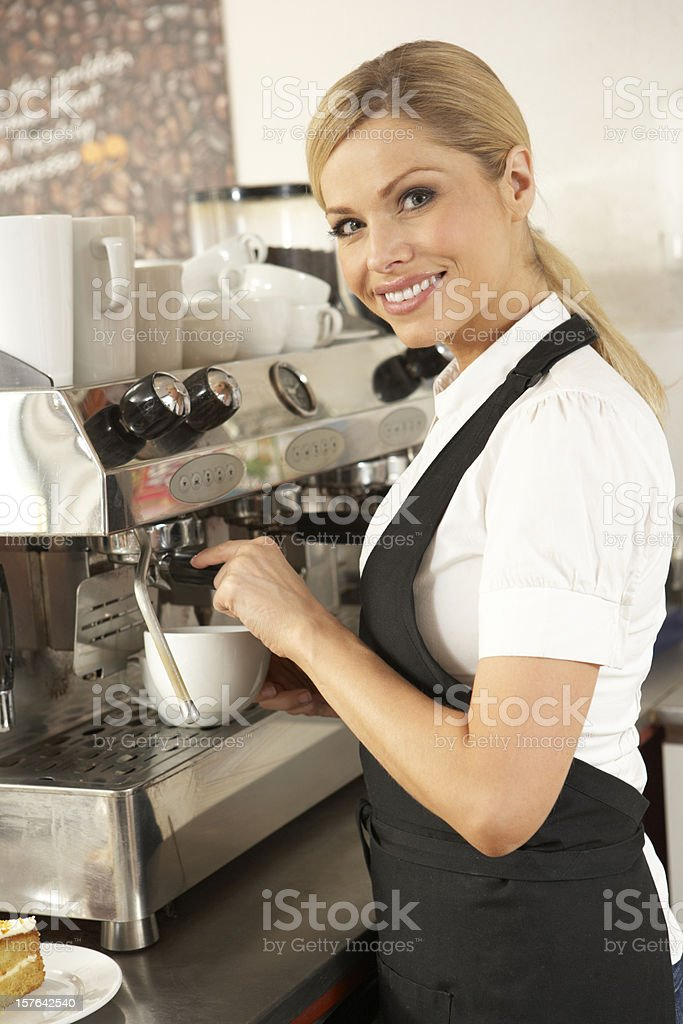 Waitress Preparing Coffee In Café royalty-free stock photo