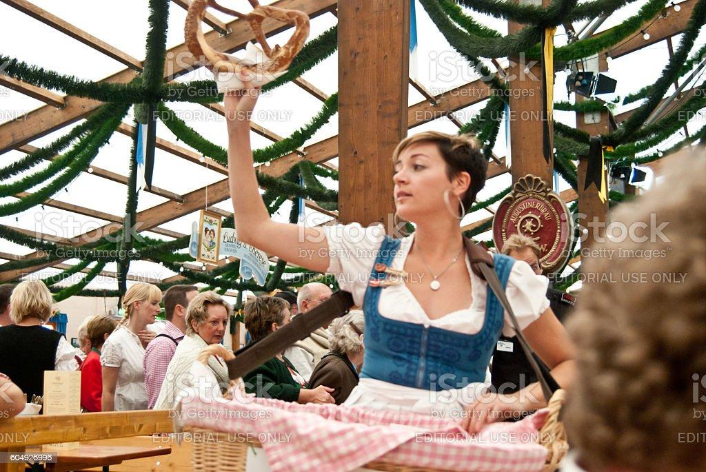 Waitress selling brezen on the Oktoberfest stock photo
