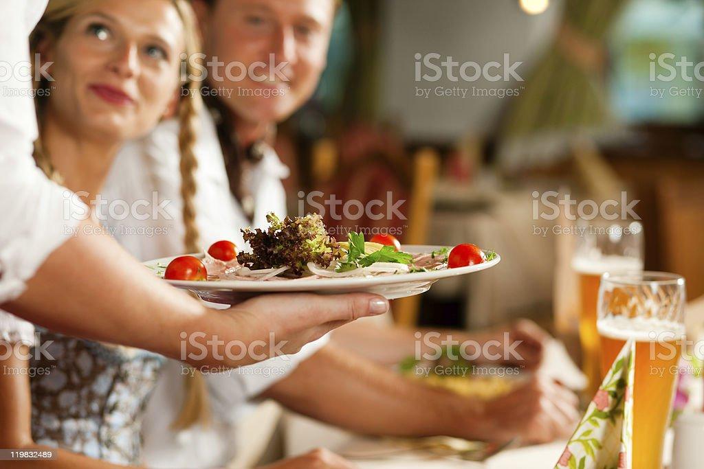 Waitress serving an Bavarian Restaurant stock photo