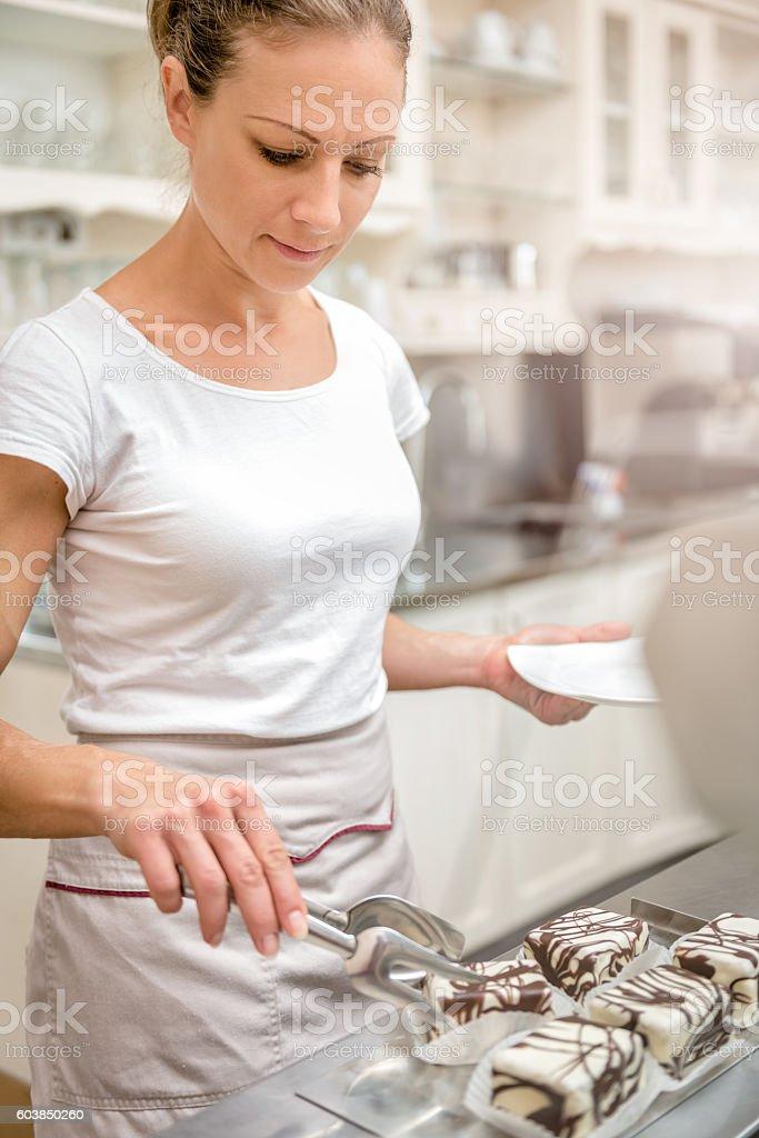 Waitress serving cakes stock photo