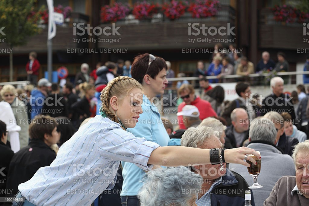 waitress serving coffee at agriculture show in switzerland royalty-free stock photo