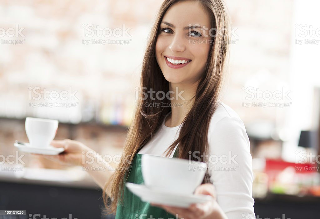 Waitress serving coffee stock photo