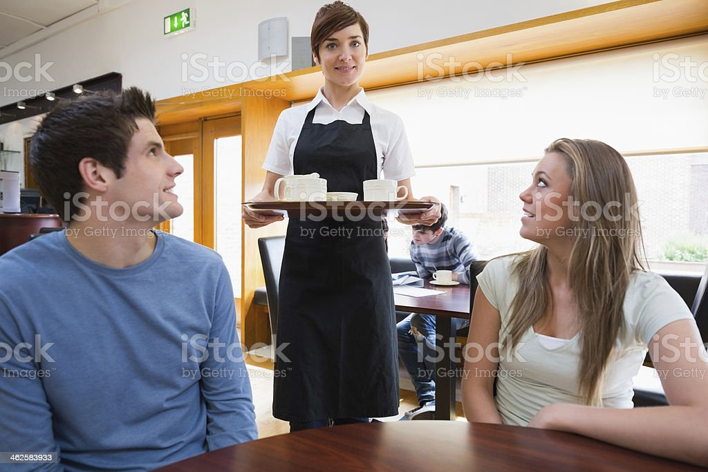 Waitress serving coffee royalty-free stock photo