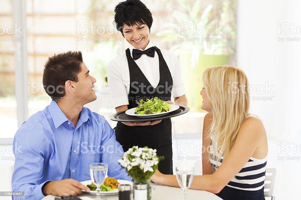 waitress serving customers royalty-free stock photo