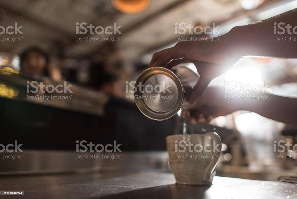 Waitress serving drinks at a restaurant stock photo