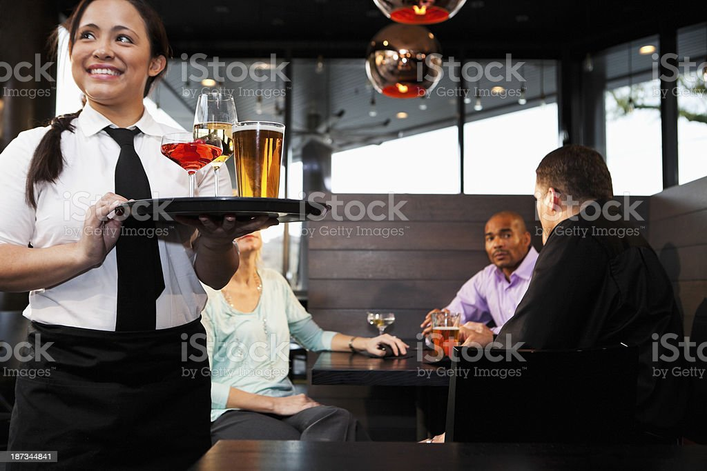 Waitress serving drinks at restaurant royalty-free stock photo