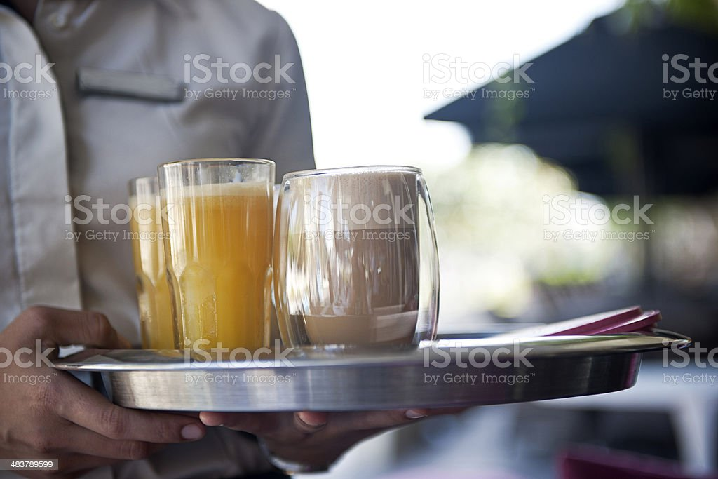 Waitress serving drinks royalty-free stock photo
