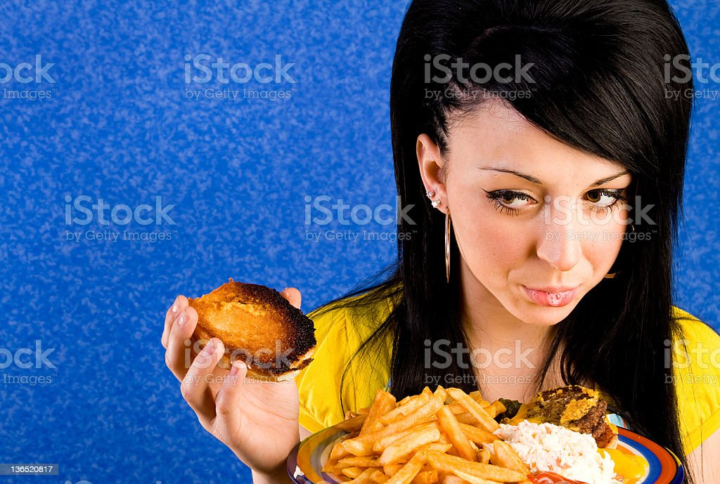 Waitress Spitting in Burger! stock photo