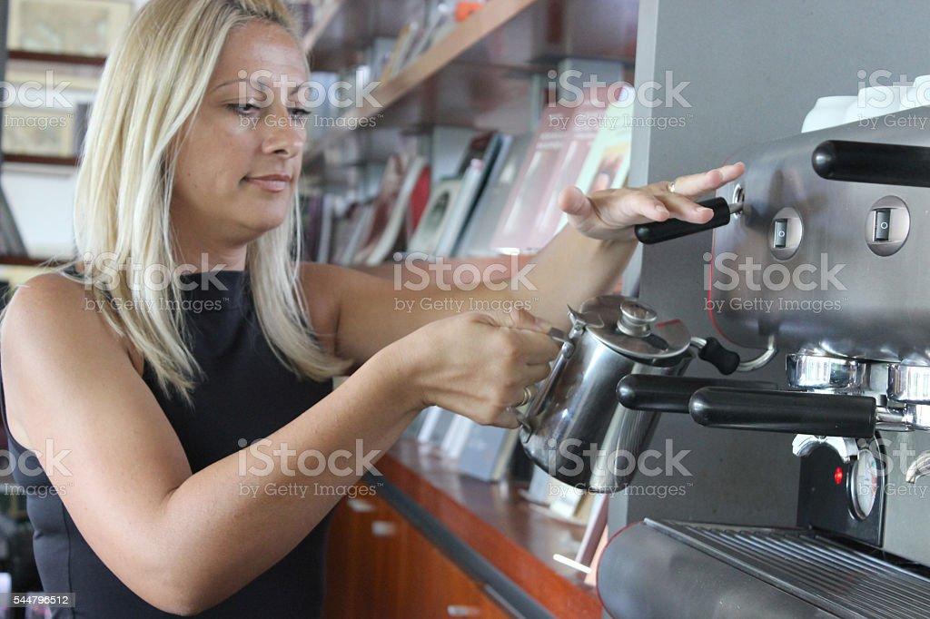 Waitress steaming milk stock photo