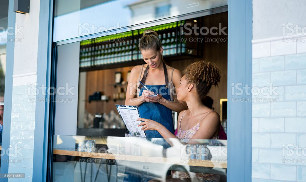 Waitress taking orders at a restaurant stock photo