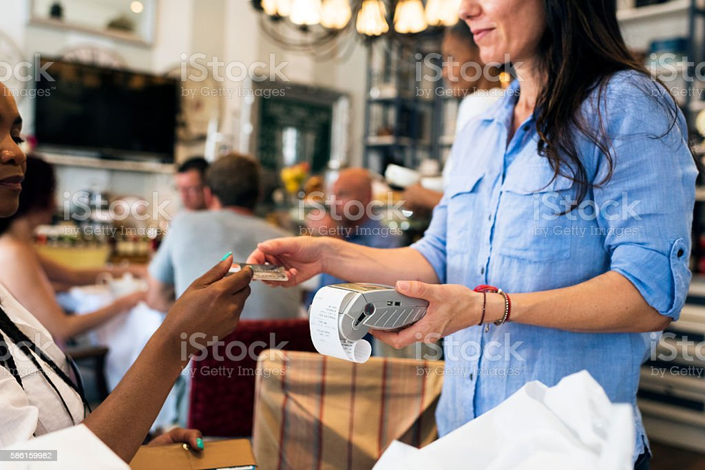 Waitress Taking Payment With Credit Card Terminal stock photo
