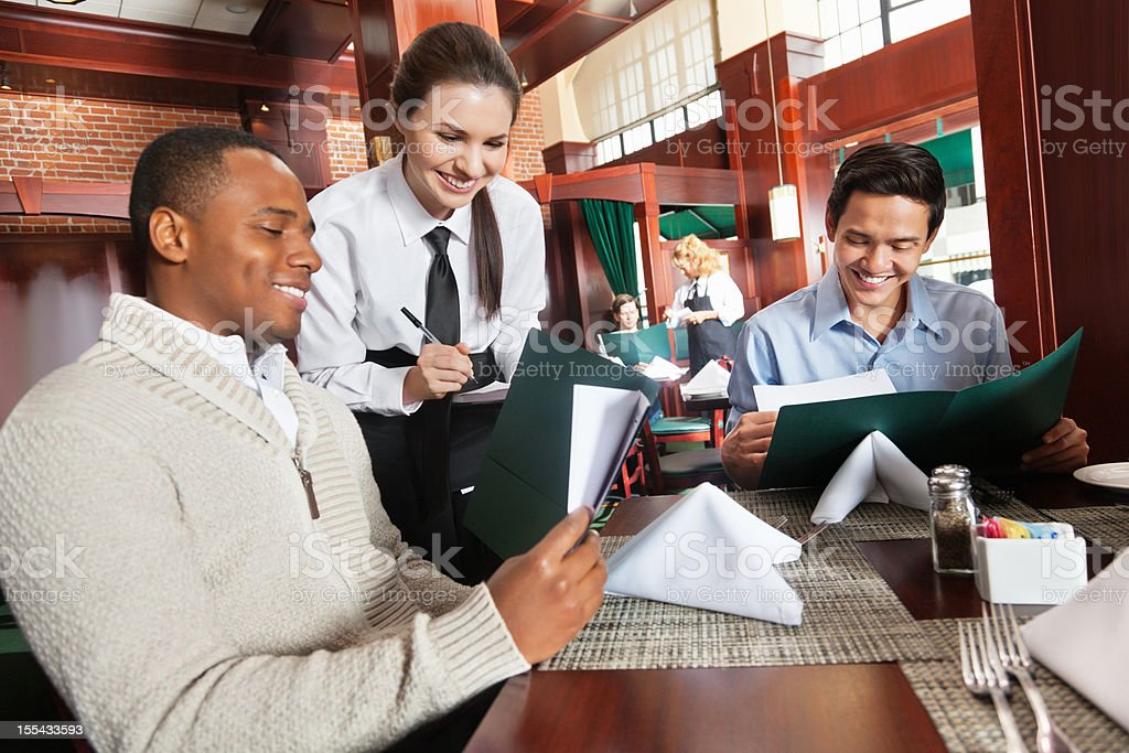 Waitress taking restaurant guest's order stock photo