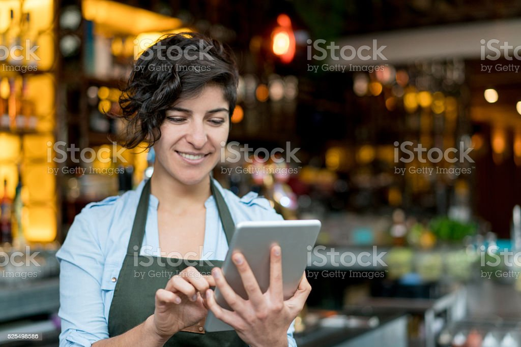 Waitress using a tablet computer stock photo