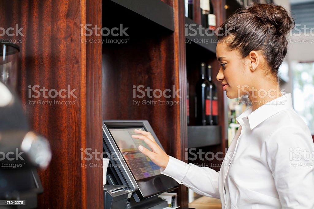 Waitress Using Cash Register In Restaurant royalty-free stock photo