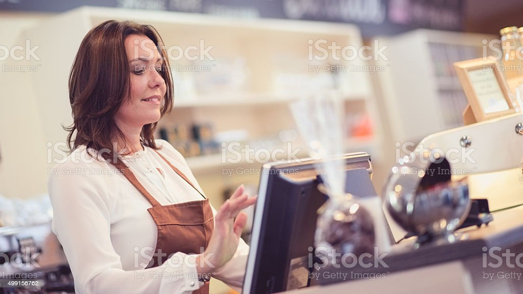 Waitress using touch screen cash register stock photo