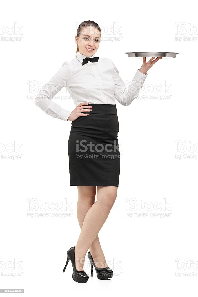 Waitress with bow tie holding an empty tray stock photo