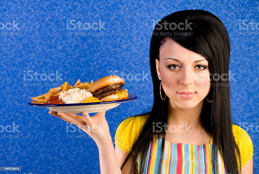 Waitress with burger and fries stock photo