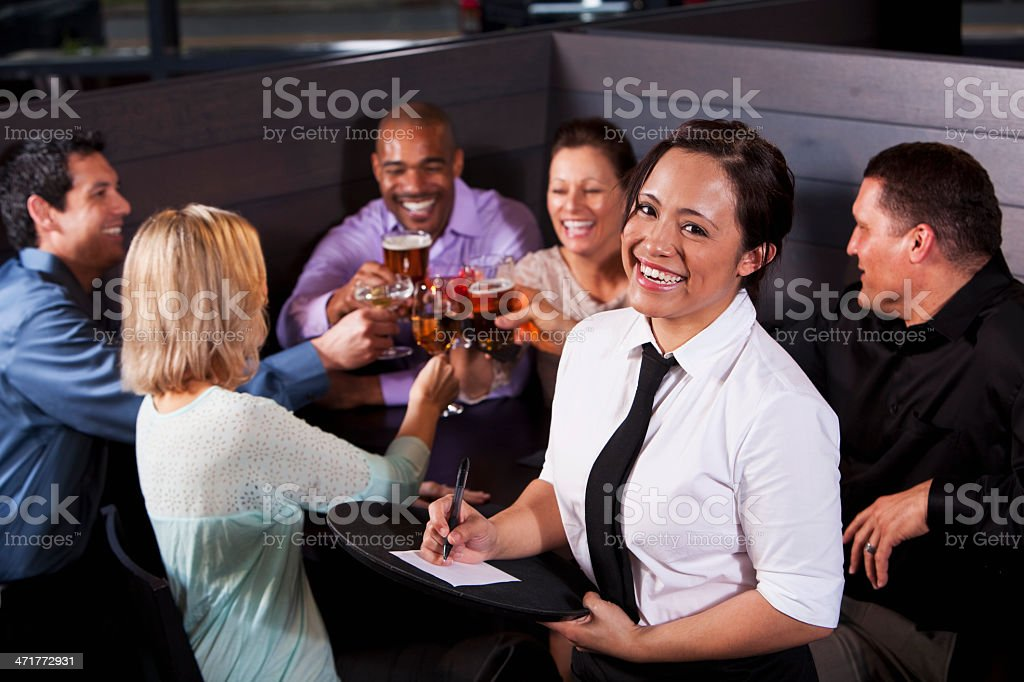Waitress with group of customers royalty-free stock photo