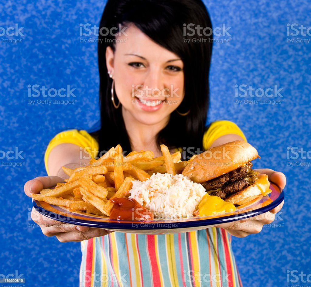 waitress with plate of burger and fries stock photo