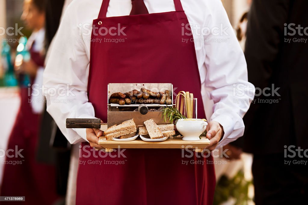 Waitress With Sausage Bread And Sauce royalty-free stock photo