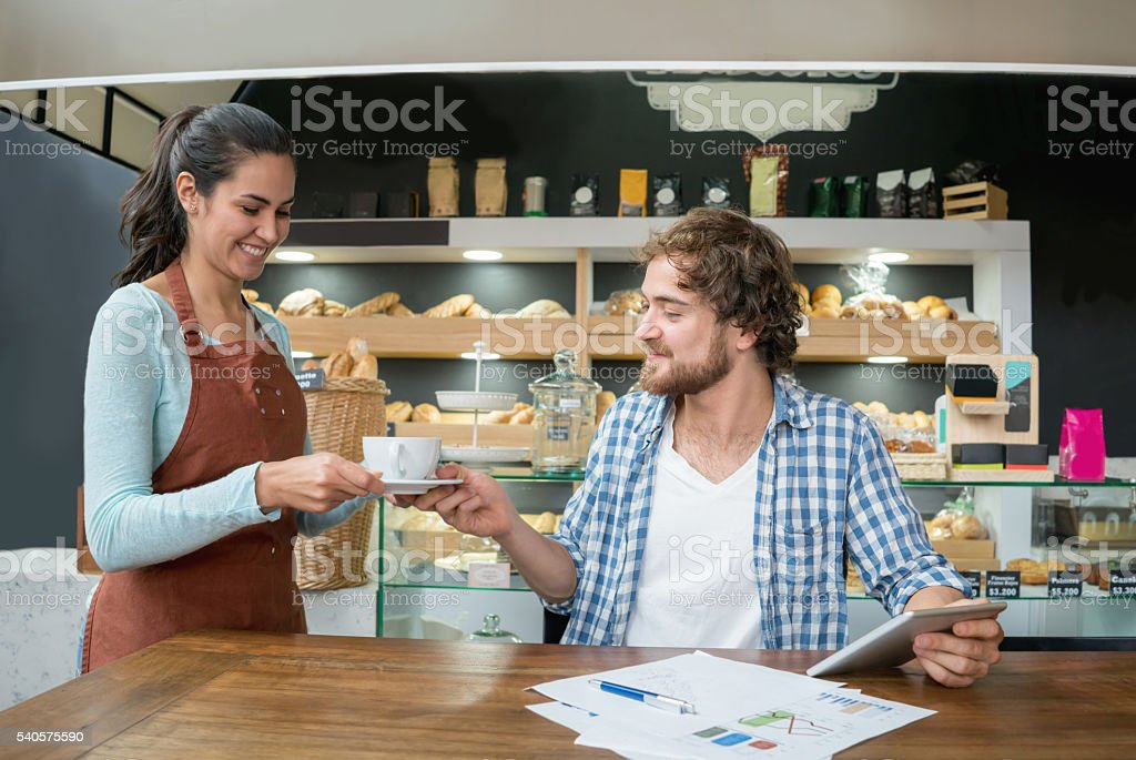 Waitress working at a cafe stock photo