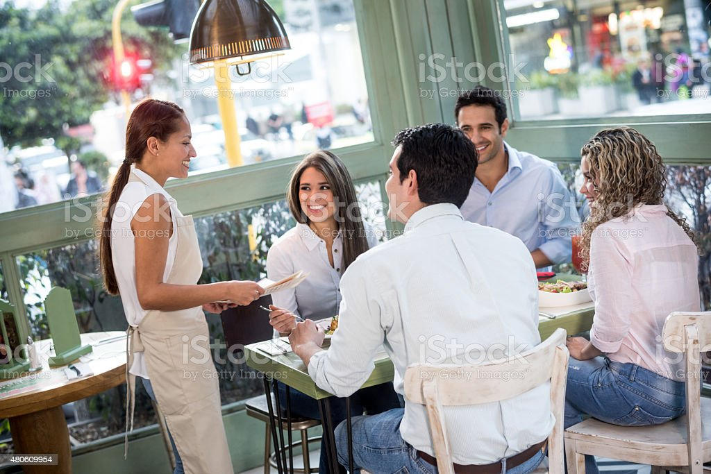 Waitress working at a restaurant stock photo