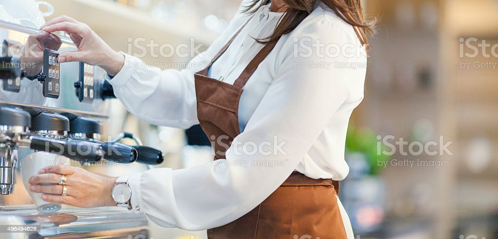 Waitress working in a coffee shop stock photo