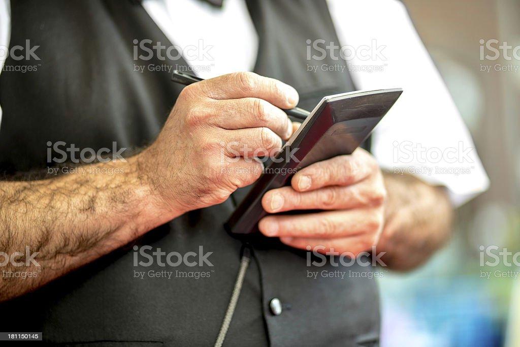 Waitress writing in order pad at restaurant stock photo