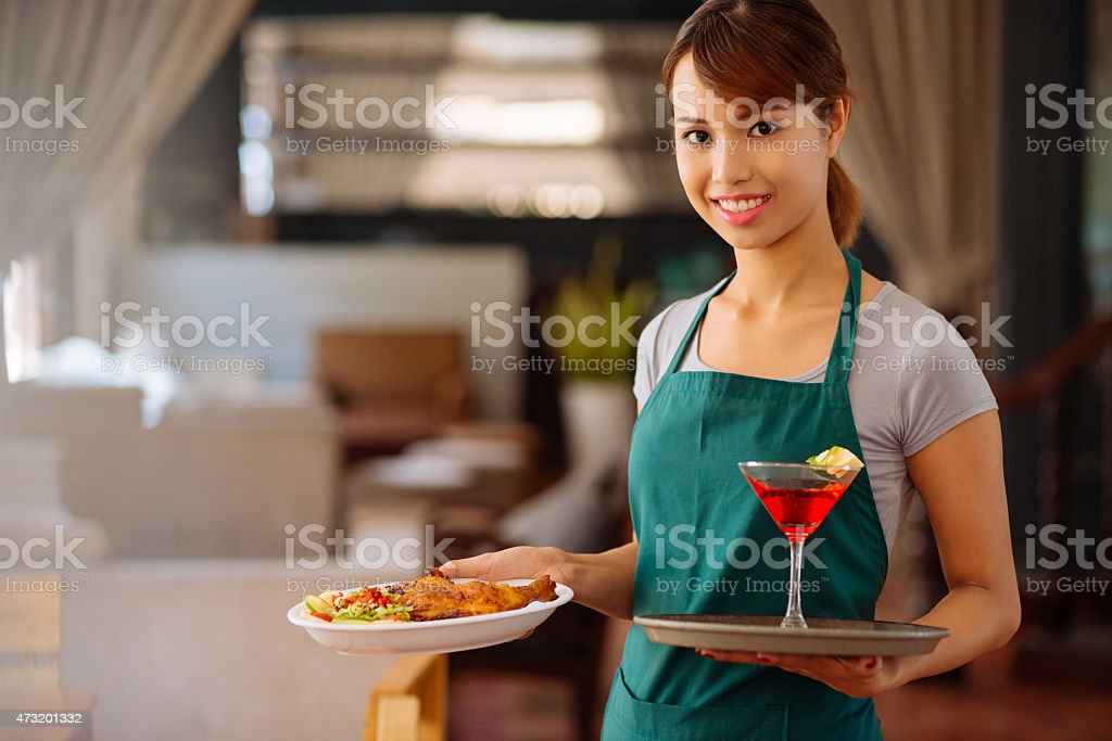 Waitstaff Carrying a Plate of Food and a Red Drink stock photo