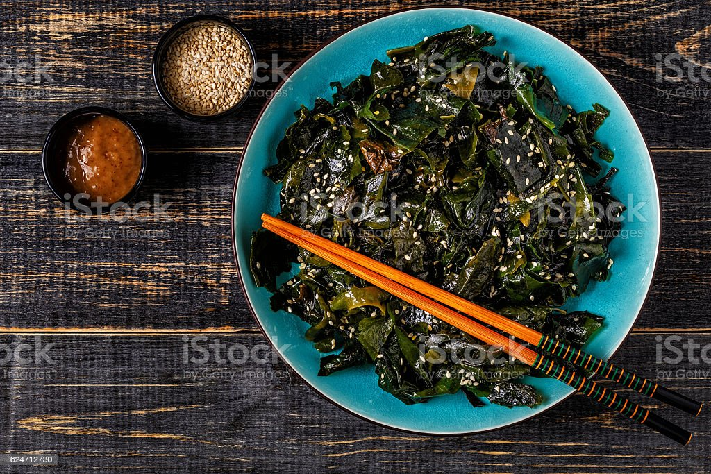 Wakame salad, raw seaweed, Japanese cuisine. stock photo