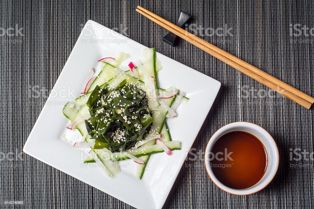 Wakame seaweed salad with cucumber stock photo