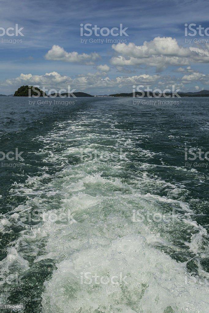 wake behind the boat royalty-free stock photo