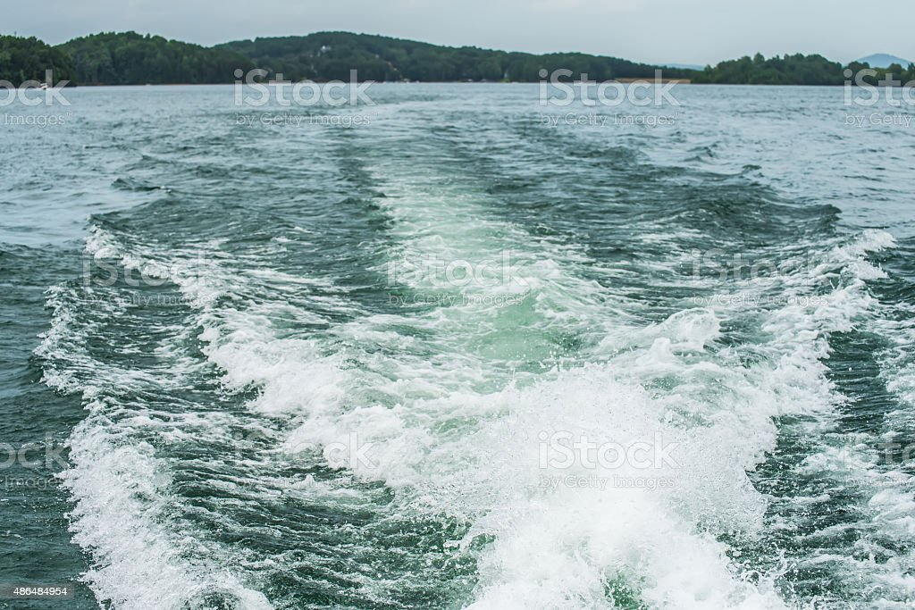 wake from a boat on lake stock photo