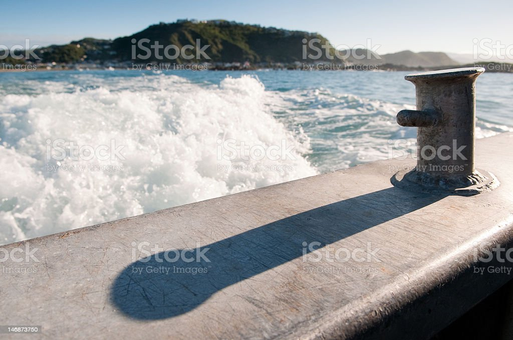 Wake from back of commerical fishing boat. stock photo