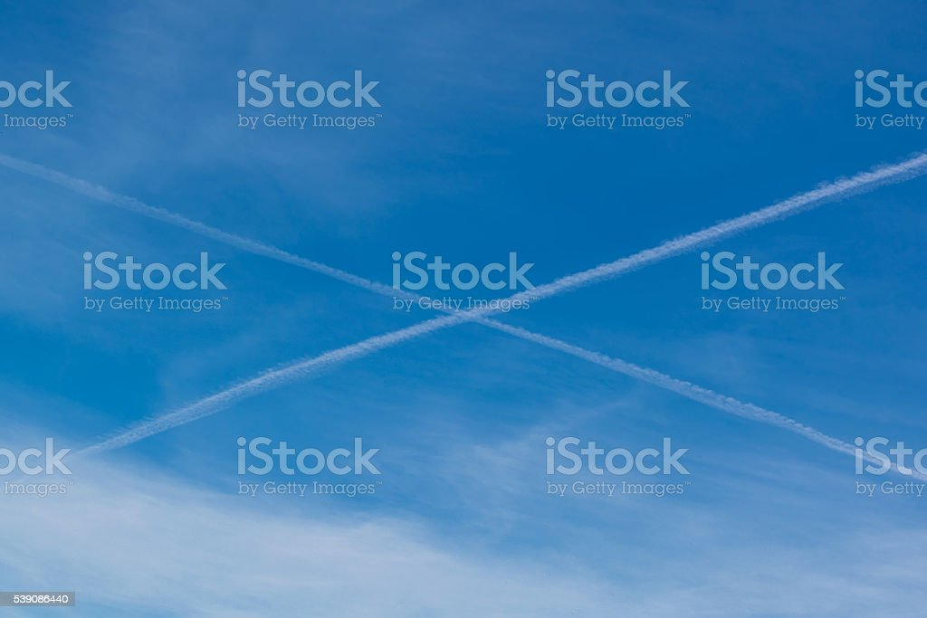 wake in the sky with the form of x stock photo