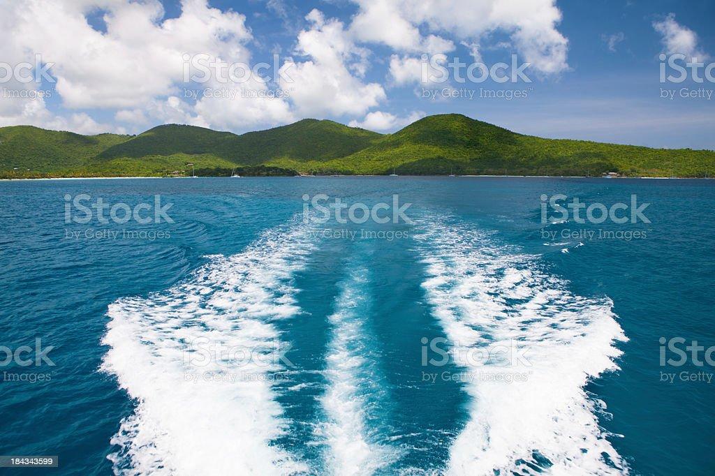 wake of a boat leaving St. John, US Virgin Islands stock photo