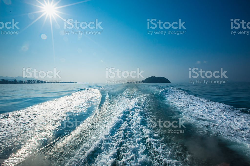 Wake of a ferry boat. in Thailand stock photo