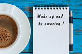 Wake Up and Be Amazing message text written in notepad