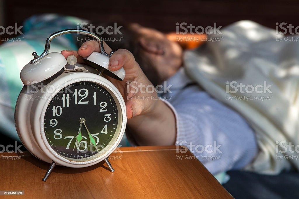 Wake up, the alarm clock rings stock photo