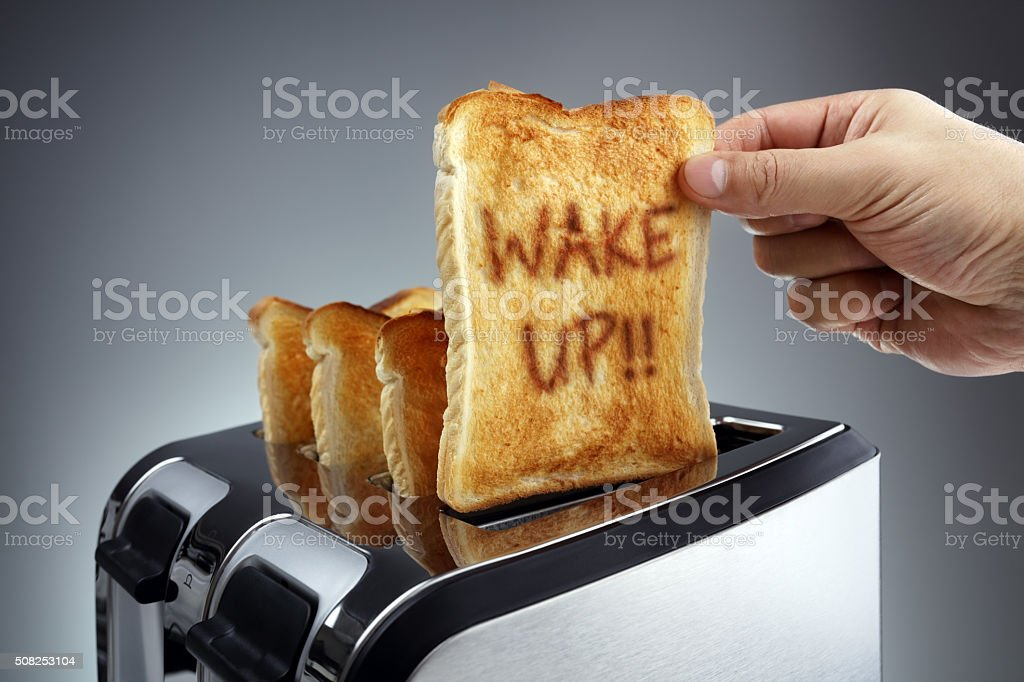 Wake up toasted bread in a toaster stock photo