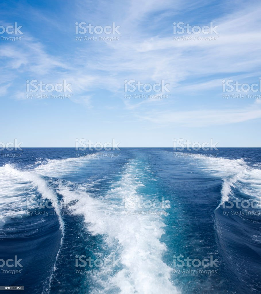 Wake waves created by a boat stock photo