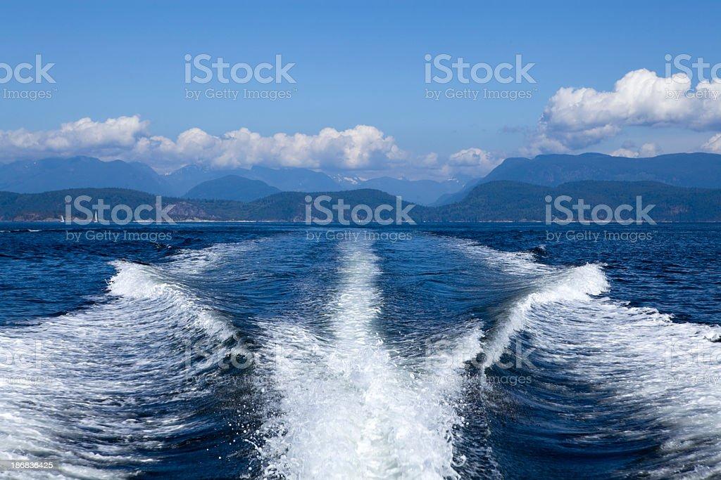 Wake waves made from motor yacht boat royalty-free stock photo