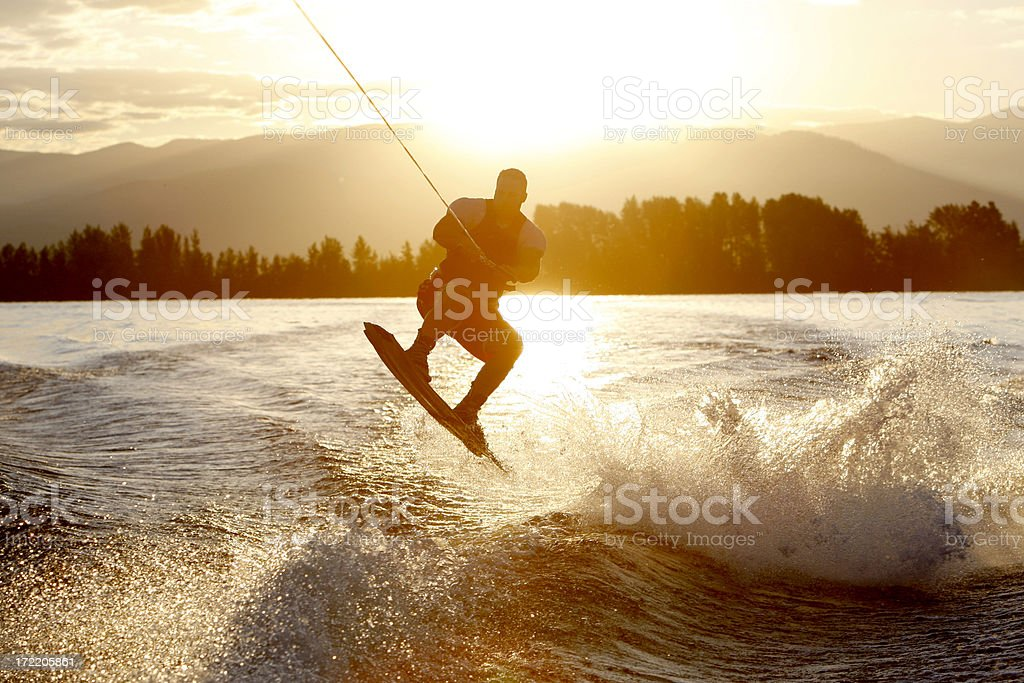 wakeboarder at sunrise stock photo