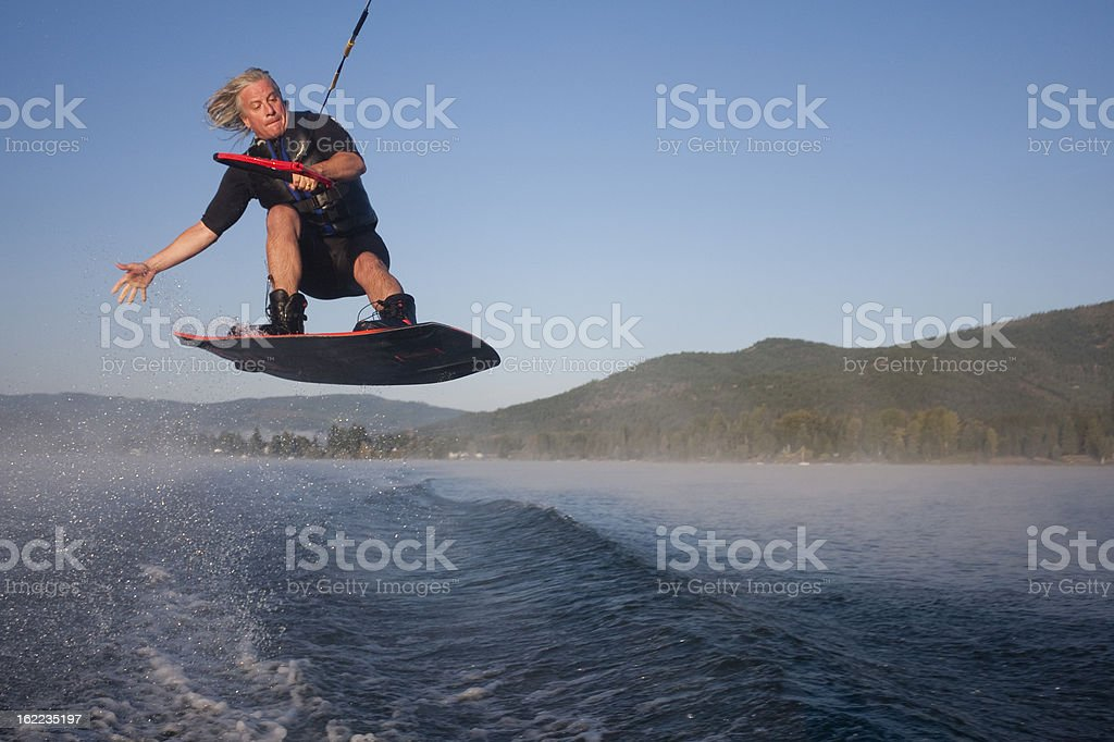 Wakeboarder catching air stock photo